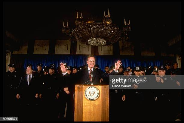 Republican presidential candidate VP George Bush speaking framed by police officers in endorsement of his candidacy by Boston police