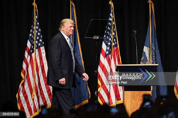Republican presidential candidateDonald Trump walks onto stage at a rally on May 26 2016 in Bismarck North Dakota According to a delegate count...
