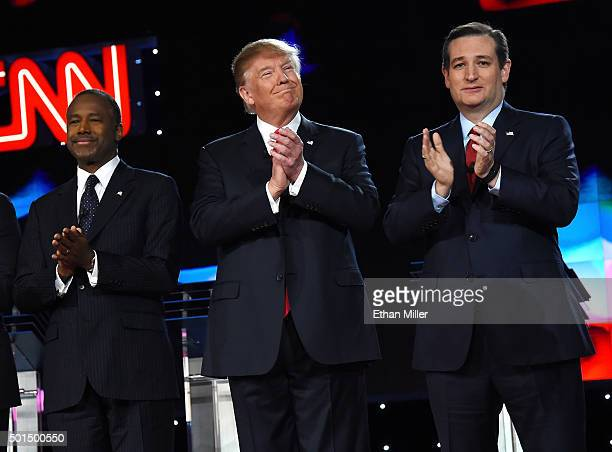 Republican presidential candidates Ben Carson Donald Trump and Sen Ted Cruz stand onstage as they are introduced during the CNN presidential debate...