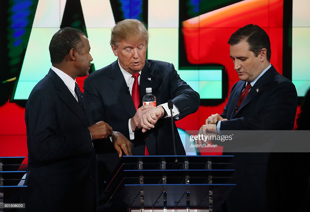 Republican presidential candidates Ben Carson, Donald Trump and U.S. Sen. Ted Cruz (R-TX) look at their watches during the CNN Republican presidential debate on December 15, 2015 in Las Vegas, Nevada. This is the last GOP debate of the year, with U.S. Sen. Ted Cruz (R-TX) gaining in the polls in Iowa and other early voting states and Donald Trump rising in national polls.