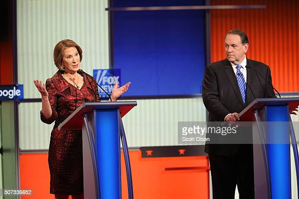 Republican presidential candidates Carly Fiorina and Mike Huckabee participate in the Fox News Google GOP Debate January 28 2016 at the Iowa Events...