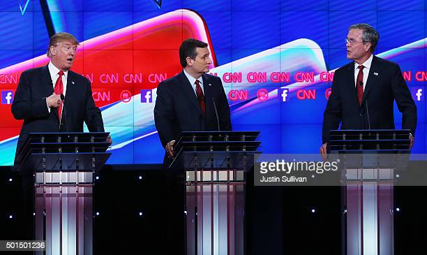 Republican presidential candidates Donald Trump and Jeb Bush repond to each other as US Sen Ted Cruz listens during the CNN Republican presidential...