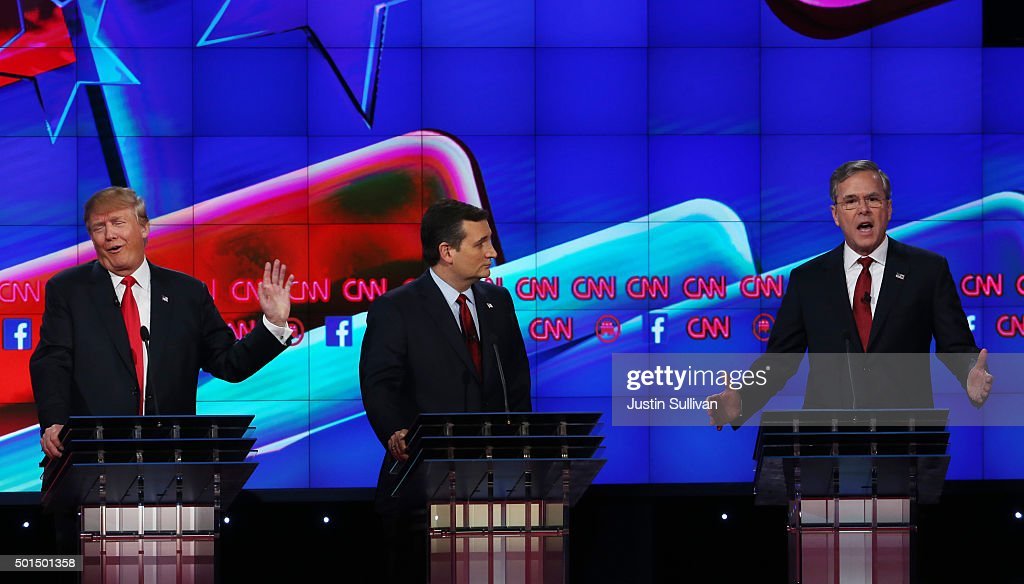 Republican presidential candidates Donald Trump (L) and Jeb Bush (R) repond to each other as U.S. Sen. Ted Cruz (R-TX) listens during the CNN Republican presidential debate on December 15, 2015 in Las Vegas, Nevada. This is the last GOP debate of the year, with U.S. Sen. Ted Cruz (R-TX) gaining in the polls in Iowa and other early voting states and Donald Trump rising in national polls.