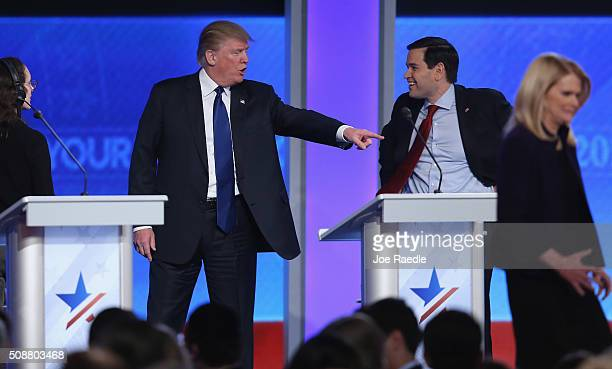 Republican presidential candidates Donald Trump and Sen Marco Rubio visit during a commercial break in the Republican presidential debate at St...