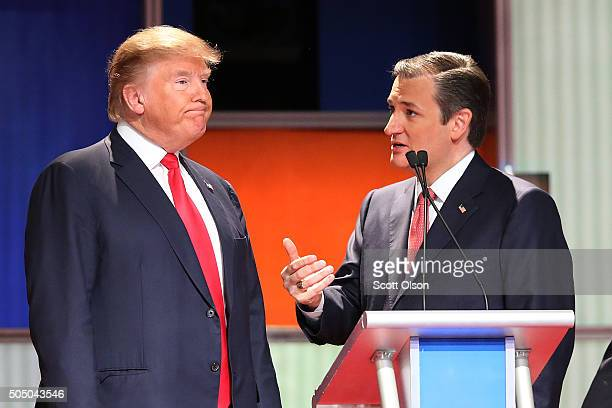 Republican presidential candidates Donald Trump and Sen Ted Cruz speak during a commercial break in the Fox Business Network Republican presidential...
