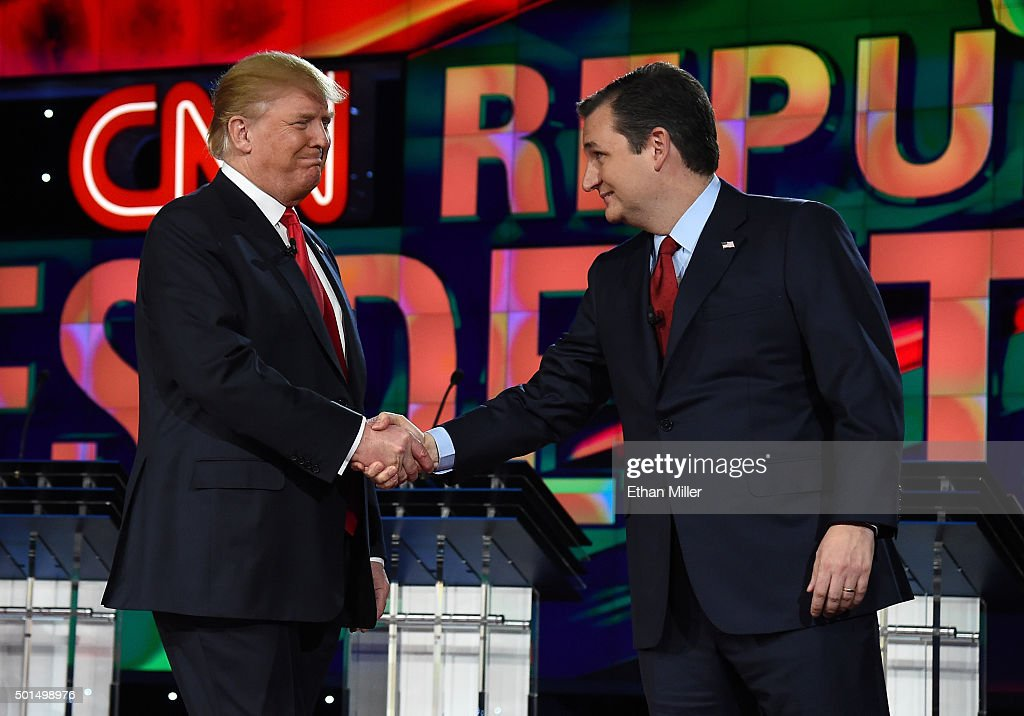 Republican presidential candidates Donald Trump (L) and Sen. Ted Cruz (R-TX) shake hands as they are introduced during the CNN presidential debate at The Venetian Las Vegas on December 15, 2015 in Las Vegas, Nevada. Thirteen Republican presidential candidates are participating in the fifth set of Republican presidential debates.