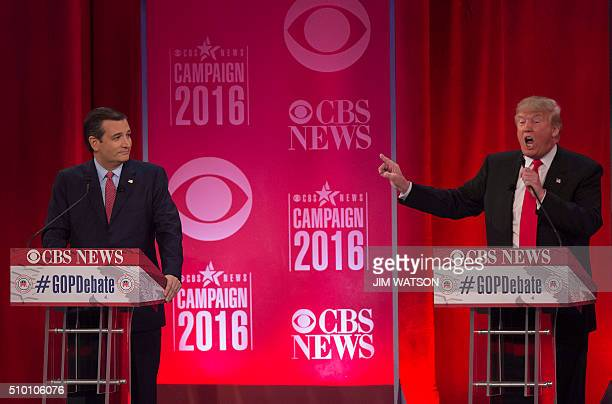 Republican presidential candidates Donald Trump and Ted Cruz argue during the CBS News Republican Presidential Debate in Greenville South Carolina...