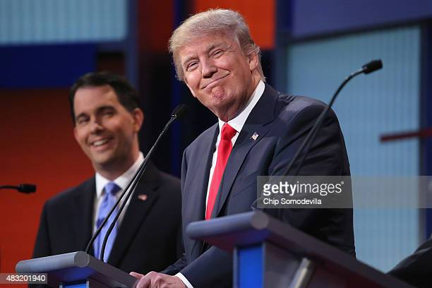 Republican presidential candidates Donald Trump and Wisconsin Gov Scott Walker participate in the first primetime presidential debate hosted by FOX...