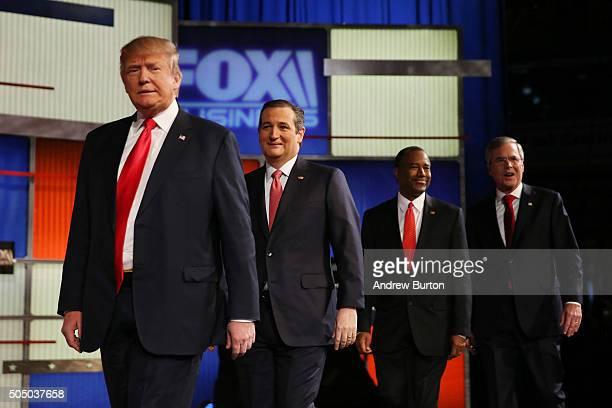 Republican presidential candidates Donald Trump Sen Ted Cruz Ben Carson and Jeb Bush arrive to participate in the Fox Business Network Republican...