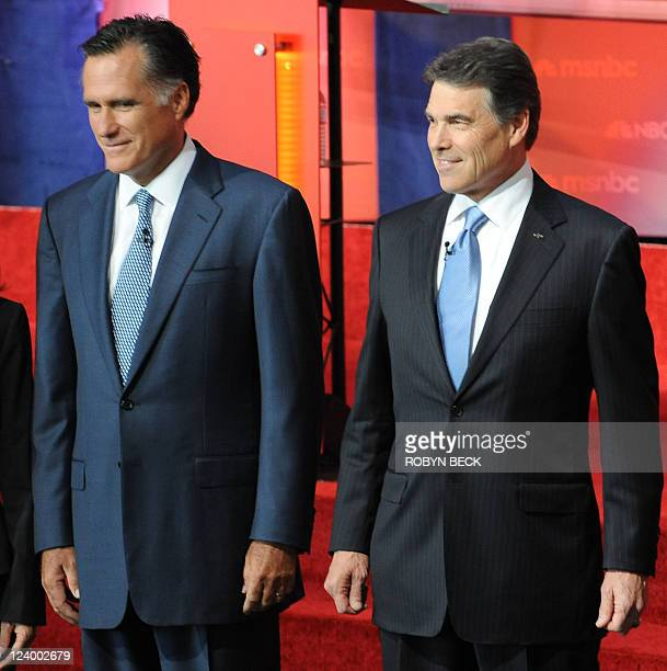 Republican presidential candidates former Governor of Massachusetts Mitt Romney and Texas Governor Rick Perry pose for photographs on September 7...