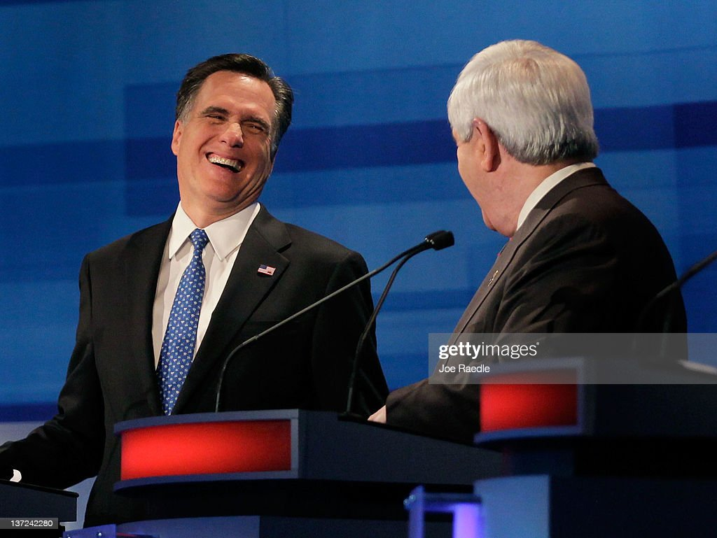 Republican Presidential candidates, former Massachusetts Gov. Mitt Romney (L) and former U.S. House Speaker Newt Gingrich (R-GA) share a laugh during a Fox News, Wall Street Journal-sponsored debate at the Myrtle Beach Convention Center, on January 16, 2012 in Myrtle Beach, South Carolina. Voters in South Carolina will head to the polls on January 21st. to vote in the Republican primary election to pick their choice for U.S. presidential candidate.