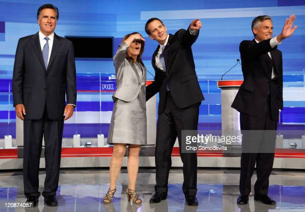 Republican presidential candidates former Massachusetts Governor Mitt Romney Rep Michele Bachmann former Minnesota Governor Tim Pawlenty and former...