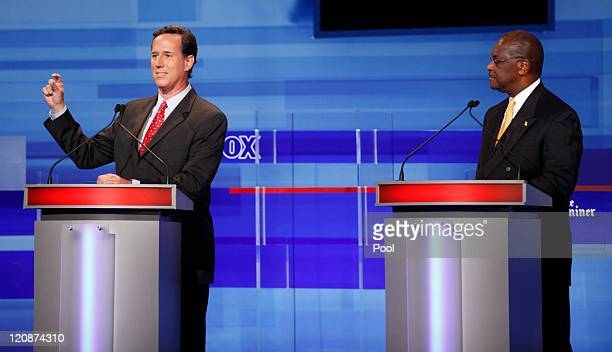 Republican presidential candidates former Pennsylvania Sen Rick Santorum and businessman Herman Cain are pictured during the Iowa GOP/Fox News Debate...