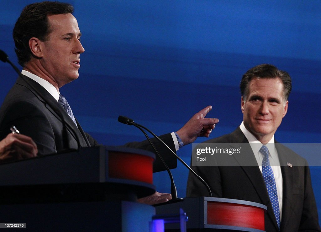 Republican presidential candidates (L-R) former U.S. Sen. Rick Santorum of Pennsylvania and former Massachusetts Gov. Mitt Romney participate in a Fox News, Wall Street Journal-sponsored debate at the Myrtle Beach Convention Center on January 16, 2012 in Myrtle Beach, South Carolina. Voters in South Carolina will head to the polls on January 21 to vote in the Republican primary election to pick their choice for U.S. presidential candidate.
