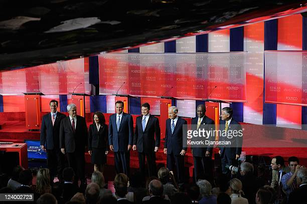 Republican presidential candidates from left Rick Santorum Newt Gingrich Michele Bachmann Mitt Romney Rick Perry Ron Paul Herman Cain and Jon...