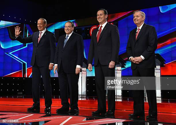 Republican presidential candidates George Pataki Mike Huckabee Rick Santorum and Sen Lindsey Graham are introduced during the CNN presidential debate...