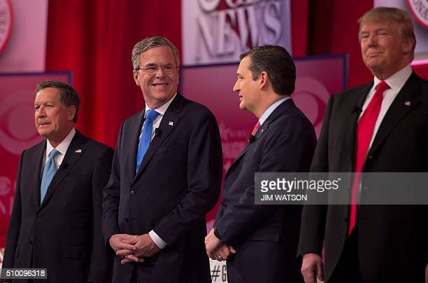 Republican presidential candidates John Kasich and Donald Trump look on as Jeb Bush confers with Ted Cruz during the CBS News Republican Presidential...