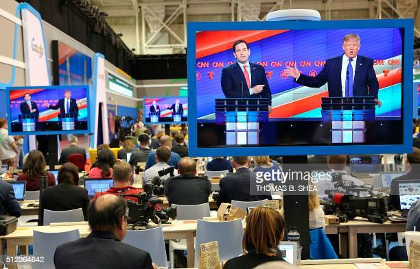Republican Presidential Candidates Marco Rubio and Donald Trump are seen on television in the CNN filing room during the Republican Presidential...