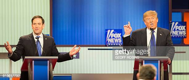 Republican Presidential Candidates Marco Rubio and Donald Trump spar during the Republican Presidential Debate in Detroit Michigan March 3 2016 / AFP...
