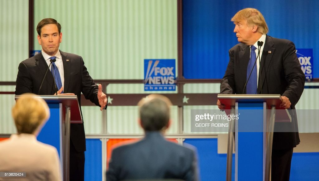 Republican Presidential Candidates Marco Rubio (L) and Donald Trump spar during the Republican Presidential Debate in Detroit, Michigan, March 3, 2016. PHOTO / Geoff Robins