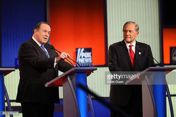 Republican presidential candidates Mike Huckabee and Jim Gilmore participate in the Fox News Google GOP Debate January 28 2016 at the Iowa Events...
