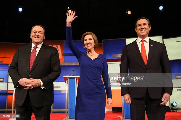 Republican presidential candidates Mike Huckabee Carly Fiorina and Rick Santorum arrive on stage at the Fox Business Network Republican presidential...