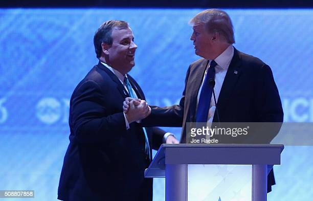 Republican presidential candidates New Jersey Governor Chris Christie and Donald Trump shake hands during a commercial break in the Republican...