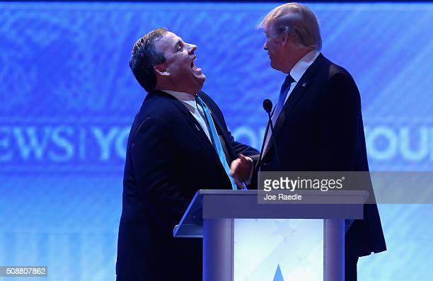 Republican presidential candidates New Jersey Governor Chris Christie and Donald Trump share a laugh during a commercial break in the Republican...