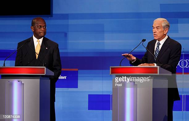 Republican presidential candidates Rep Ron Paul RTexas and businessman Herman Cain are pictured during the Iowa GOP/Fox News Debate on August 11 2011...
