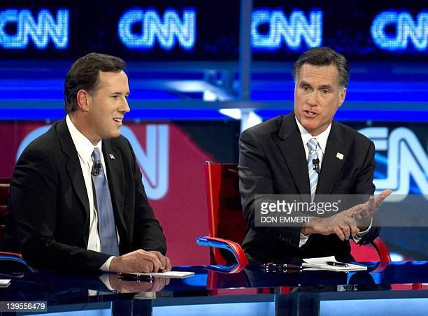 Republican presidential candidates Rick Santorum and Mitt Romney debate on February 22 2012 in Mesa Arizona The Arizona and Michigan primaries are...