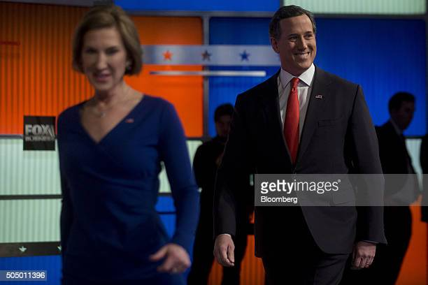 Republican presidential candidates Rick Santorum former senator from Pennsylvania right and Carly Fiorina former chairman and chief executive officer...