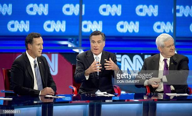 Republican presidential candidates Rick Santorum Mitt Romney and Newt Gingrich debate on February 22 2012 in Mesa Arizona The Arizona and Michigan...