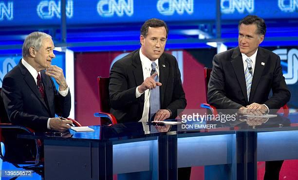 Republican presidential candidates Ron Paul Rick Santorum and Mitt Romney debate on February 22 2012 in Mesa Arizona The Arizona and Michigan...