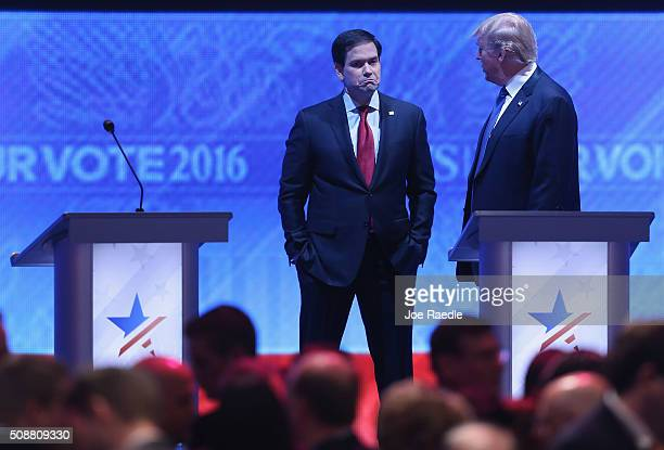 Republican presidential candidates Sen Marco Rubio and Donald Trump talk during a commercial break in the Republican presidential debate at St Anselm...