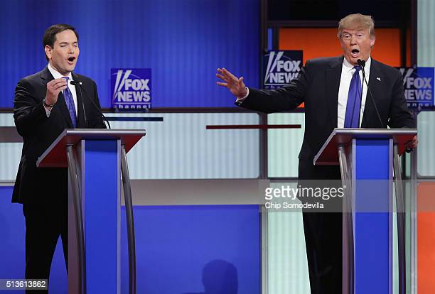 Republican presidential candidates Sen Marco Rubio and Donald Trump participate in a debate sponsored by Fox News at the Fox Theatre on March 3 2016...
