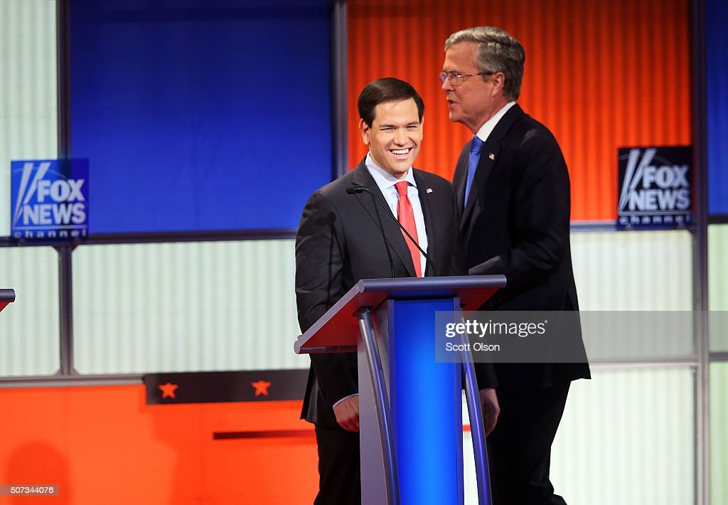 Republican presidential candidates Sen. Marco Rubio (R-FL) (L) and Jeb Bush (R) after the Fox News - Google GOP Debate January 28, 2016 at the Iowa Events Center in Des Moines, Iowa. Residents of Iowa will vote for the Republican nominee at the caucuses on February 1. Donald Trump, who is leading most polls in the state, decided not to participate in the debate.