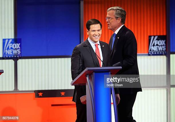 Republican presidential candidates Sen Marco Rubio and Jeb Bush after the Fox News Google GOP Debate January 28 2016 at the Iowa Events Center in Des...