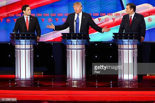 Republican presidential candidates Sen Marco Rubio and Ted Cruz listen as Donald Trump answers a question during the Republican presidential debate...