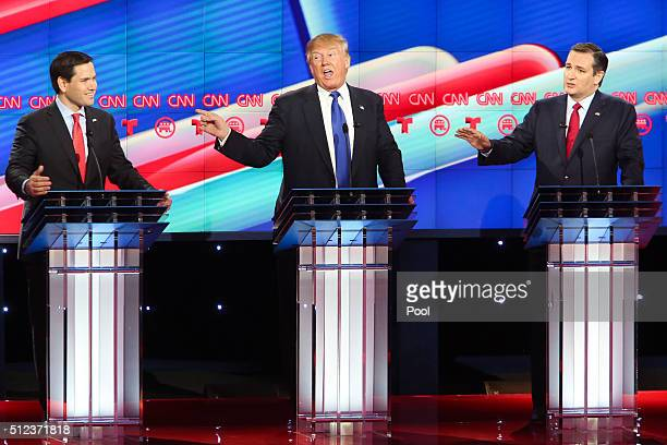 Republican presidential candidates Sen Marco Rubio Donald Trump and Sen Ted Cruz listen as answers a question during the Republican presidential...
