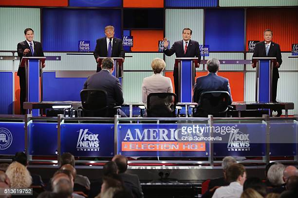 Republican presidential candidates Sen Marco Rubio Donald Trump Sen Ted Cruz and Ohio Gov John Kasich participate in a debate sponsored by Fox News...
