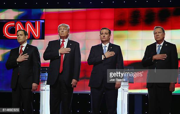 Republican presidential candidates Sen Marco Rubio Donald Trump Sen Ted Cruz and Ohio Gov John Kasich listen to the national anthem before the CNN...