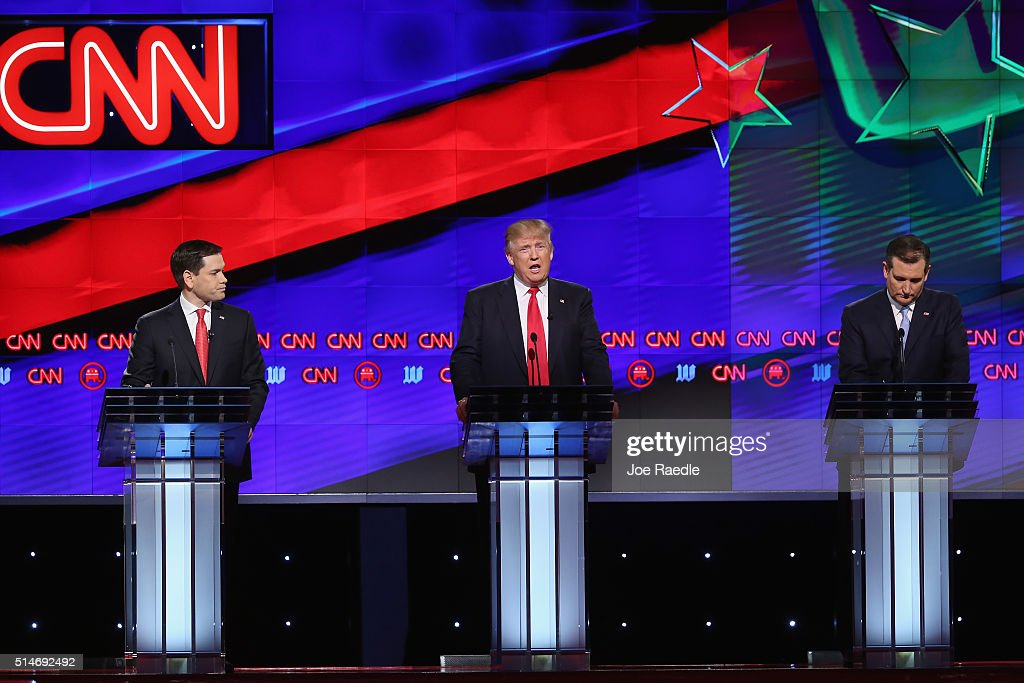 Republican presidential candidates, Sen. Marco Rubio (R-FL), Donald Trump, Sen. Ted Cruz (R-TX), and Ohio Gov. John Kasich (not seen) debate during the CNN, Salem Media Group, The Washington Times Republican Presidential Primary Debate on the campus of the University of Miami on March 10, 2016 in Coral Gables, Florida. The candidates continue to campaign before the March 15th Florida primary.