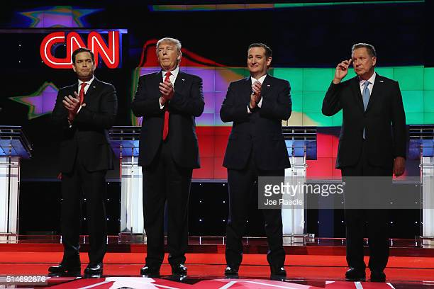 Republican presidential candidates Sen Marco Rubio Donald Trump Sen Ted Cruz and Ohio Gov John Kasich applaud after the performance of the national...