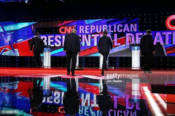 Republican presidential candidates Sen Marco Rubio Donald Trump Sen Ted Cruz and Ohio Gov John Kasich walk to their podiums at teh start of the CNN...