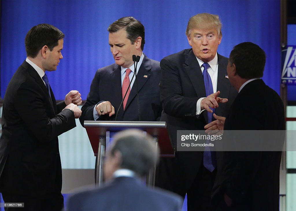 Republican presidential candidates (Lto R) Sen. Marco Rubio (R-FL), Sen. Ted Cruz (R-TX), Donald Trump and Ohio Gov. John Kasich greet each following a debate sponsored by Fox News at the Fox theatre on March 3, 2016 in Detroit, Michigan. Voters in Michigan will go to the polls March 8 for the State's primary.