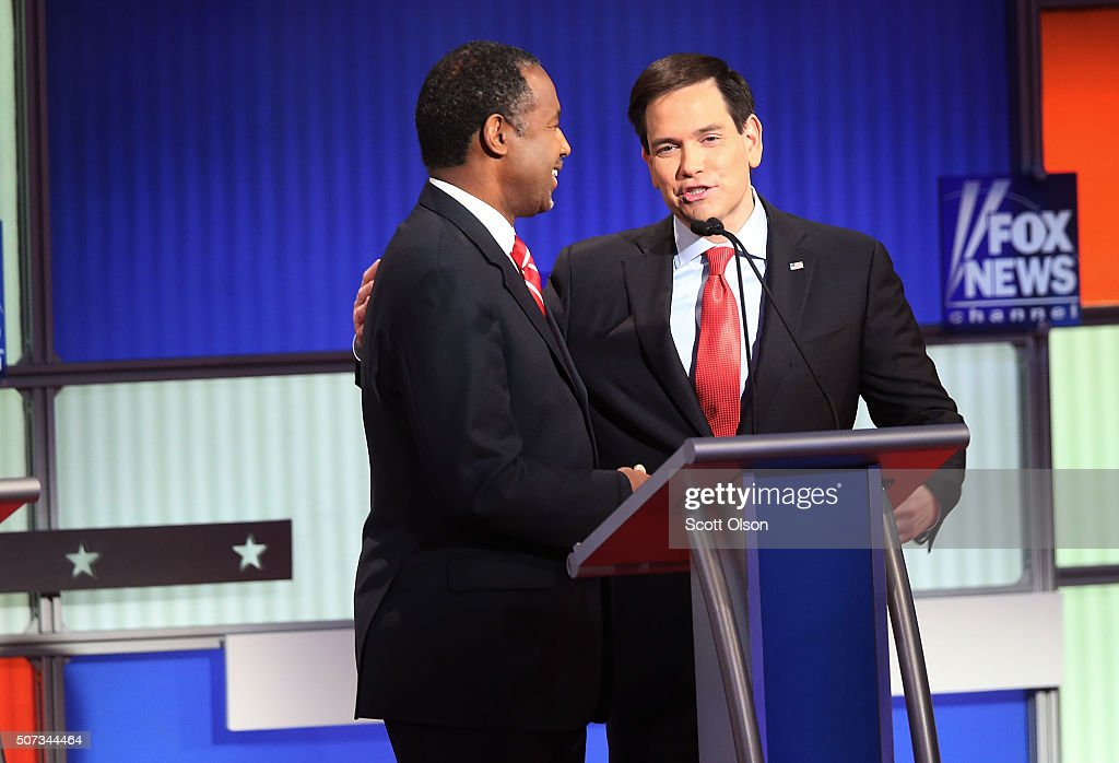 Republican presidential candidates Sen. Marco Rubio (R-FL) (R) talks to Ben Carson (L) after the Fox News - Google GOP Debate January 28, 2016 at the Iowa Events Center in Des Moines, Iowa. Residents of Iowa will vote for the Republican nominee at the caucuses on February 1. Donald Trump, who is leading most polls in the state, decided not to participate in the debate.