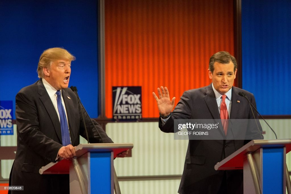 TOPSHOT - Republican Presidential candidates Ted Cruz (R) and Donald Trump spar during the Republican Presidential Debate in Detroit, Michigan, March 3, 2016. PHOTO / Geoff Robins