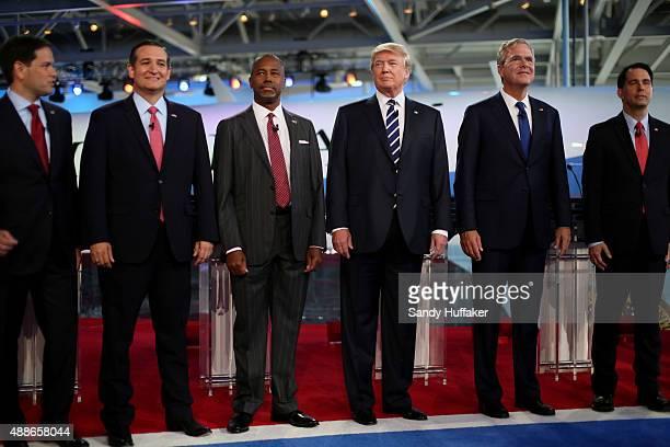 Republican presidential candidates US Sen Marco Rubio US Sen Ted Cruz Ben Carson Donald Trump Jeb Bush and Wisconsin Gov Scott Walker stand onstage...
