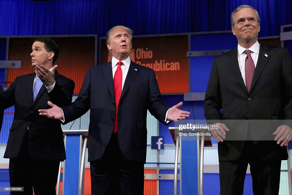 Republican presidential candidates (L-R) Wisconsin Gov. Scott Walker, Donald Trump and Jeb Bush take the stage for the first prime-time presidential debate hosted by FOX News and Facebook at the Quicken Loans Arena August 6, 2015 in Cleveland, Ohio. The top-ten GOP candidates were selected to participate in the debate based on their rank in an average of the five most recent national political polls.