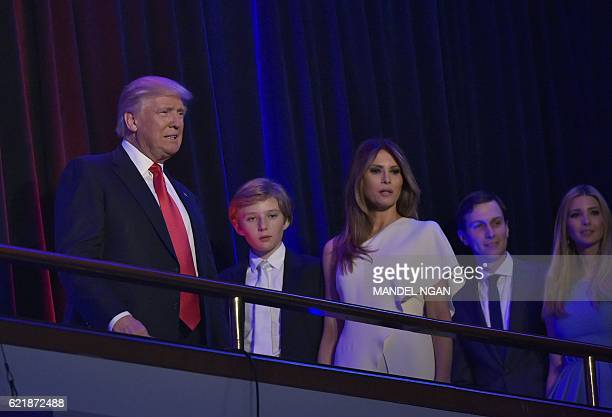 Republican presidential elect Donald Trump arrives for an election night party with his son Barron his wife Melania his soninlaw Jared Kushner and...
